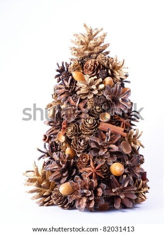 christmas tree, decoration made from natural cones, cinnamon, spices  and acorns - stock photo