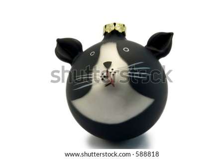 Christmas tree decoration of black and white cat - stock photo