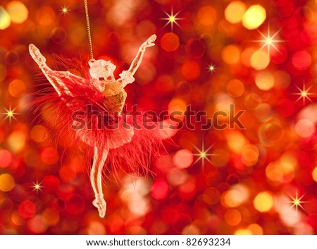 Christmas tree decoration on lights red background - stock photo