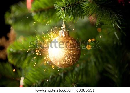 Christmas-tree decoration with shiny sparkles - stock photo