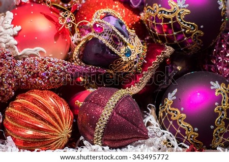 Christmas tree decorations, all in one color, crimson background