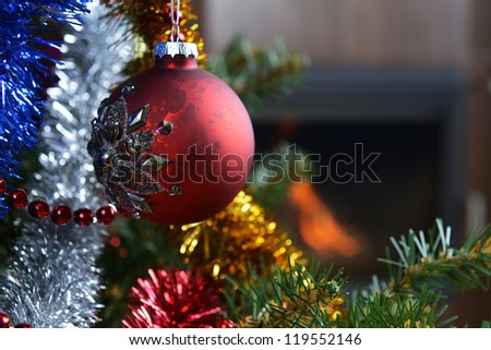 Christmas tree decorations in  interior with  fireplace
