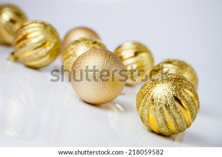 Christmas-tree decorations on neutral background