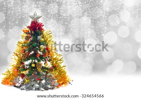 Christmas tree decorations with gift box, pine cones, bells, umbrella, ball and ribbon, for background.