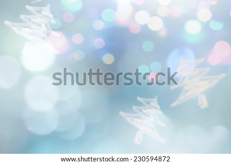Christmas tree for greeting card, abstract festive background, blue blur bokeh. - stock photo