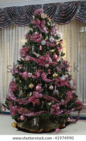Christmas tree in front of a living room window - stock photo