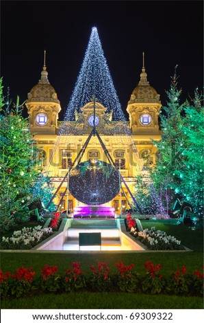 Christmas tree in front of the palace of casino of Monaco at dusk, Montecarlo, France - stock photo