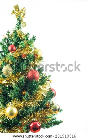 Christmas tree isolated on white with copy space for text. Seasonal image of decorated fir tree for holiday card concept