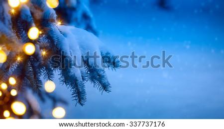 christmas tree light; blue snow background - stock photo