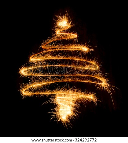 Christmas tree made by sparkler on a black background - stock photo