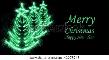 Christmas tree made by sparkler on a black background with copy space for text - stock photo