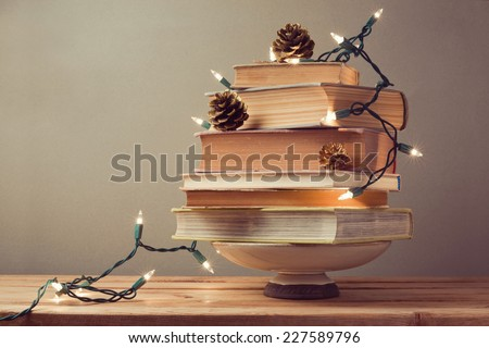 Christmas tree made from books. Alternative Christmas tree - stock photo
