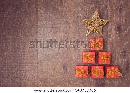 Christmas tree made from gift boxes in wooden background. View from above - stock photo