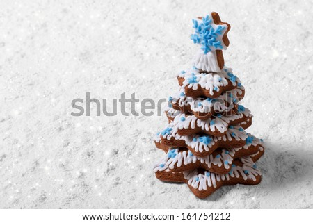 Christmas tree made of cookies on the white snow