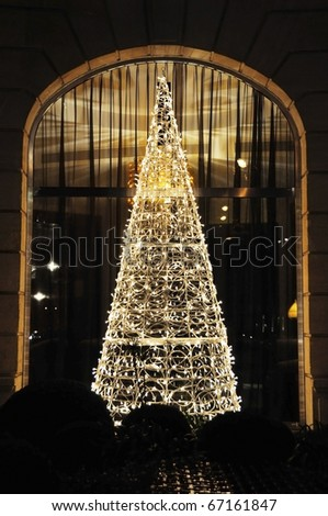 Christmas tree made of LED garlands - stock photo