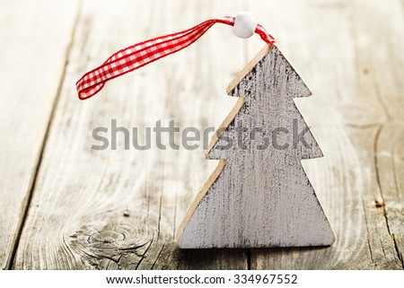 Christmas tree made of wood with rope standing on wooden background - stock photo