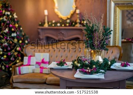 Christmas tree mirror chandelier christmas interior stock photo christmas tree mirror chandelier christmas interior in purple and gold colors aloadofball Choice Image