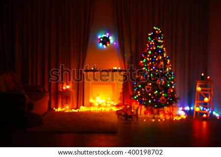 Christmas tree near fireplace and other decor in the room