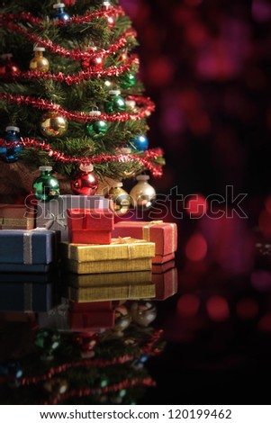 Christmas tree on abstract background with red lights