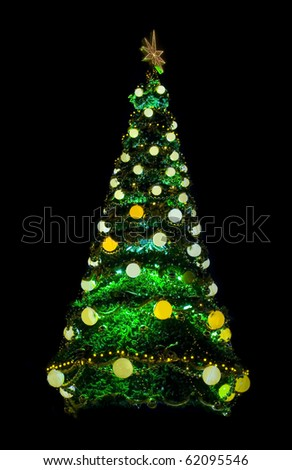 Christmas tree on black decoerated with lights and a Christmas star