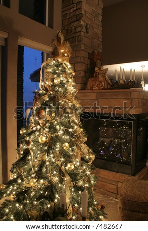 Christmas tree ornaments and fireplace