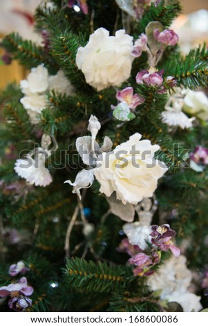 Christmas tree purple decoration with white roses and ballet dancers - stock photo
