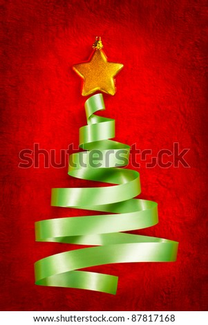 Christmas tree shape from green ribbon on red fabric