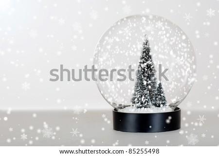 Christmas tree snow globe - stock photo