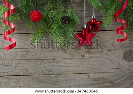 Christmas tree sprigs on wooden background. Winter holidays background - stock photo
