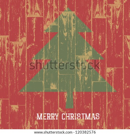 Christmas tree symbol and greetings on wooden planks texture. Raster version, vector file available in portfolio. - stock photo