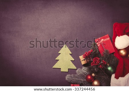 Christmas tree toy and gifts on grey background - stock photo