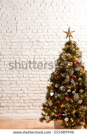Christmas tree white brick wall home