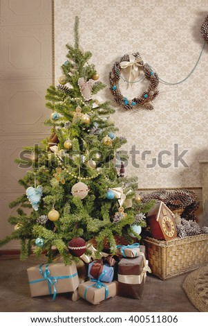 Christmas tree with a basket of cones and gifts - stock photo