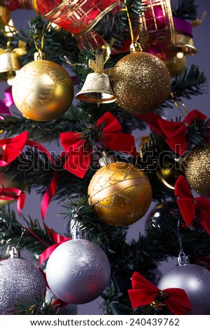 Christmas tree with a Christmas toys decoration detail  - stock photo