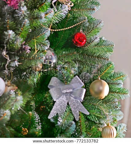 Christmas tree with balls and ornaments on a gray background