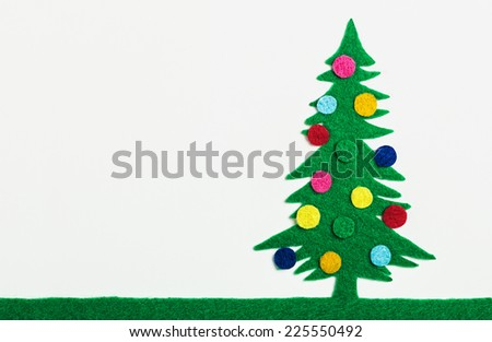 Christmas tree with balls made of felt with their hands - stock photo