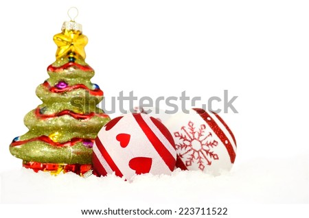 christmas tree with baubles in snow - stock photo