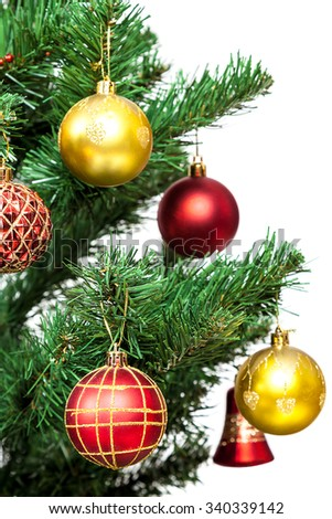 Christmas tree with baubles isolated on white background. - stock photo