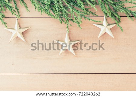 christmas tree with christmas decoration on wood background - vintage effect filter