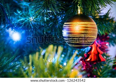 Christmas tree with christmas golden bauble - stock photo