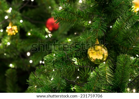 Christmas tree with decoration, detail Christmas tree in garden - stock photo