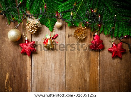 Christmas tree with decoration on old wooden board background, Christmas and New Year Holiday background