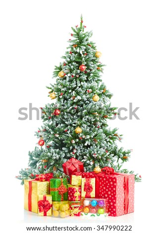 Christmas Tree with gifts isolated over white background. - stock photo