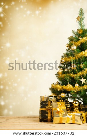 Christmas tree with golden decoration - stock photo
