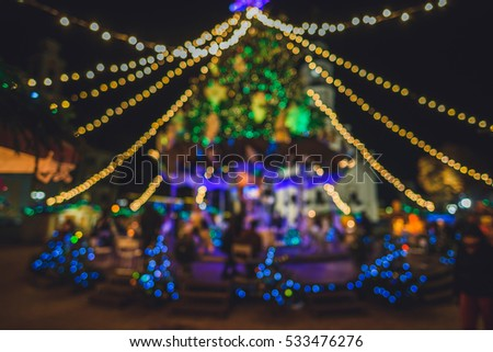 Christmas tree with lights glowing, defocused image