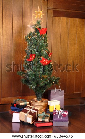Christmas tree with many colorful gifts