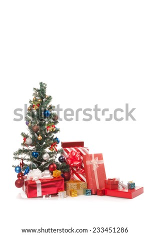 Christmas tree with  many gift boxes isolated on white background
