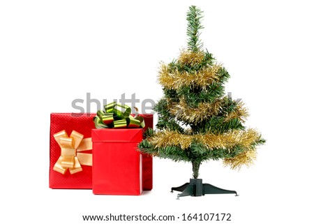 Christmas tree with present box. Isolated on a white background.