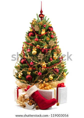 Christmas tree with presents and holiday sock - stock photo