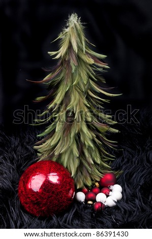 Christmas tree with red and white balls on a black background - stock photo